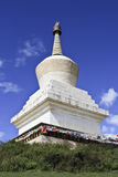 Stupa at Songzanlin Temple, largest Tibetan Buddhist monastery in Yunnan Province, China. White stupa at Songzanlin Temple, largest Tibetan Buddhist monastery Royalty Free Stock Image