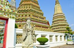 Stupa and statue in Wat Pho Royalty Free Stock Image