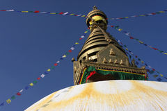 Stupa of Swayambunath and flags Stock Images