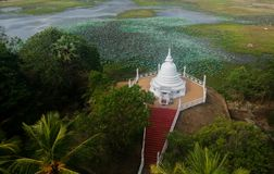 Stupa and Temple with lake in sri lanka. And beautiful location royalty free stock photo