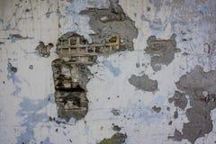 Stupad murbrukväggtextur arkivbilder