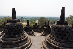 Stupas of Borobudur temple, Java, Indonesia overlooking the landscape Royalty Free Stock Images