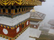 Stupas at Dochula Pass in the fog in Bhutan Stock Images