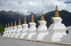 Stupas Infront of Sacred Buddhist Meili Mountain Royalty Free Stock Photo