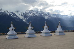 Stupas Infront of Sacred Buddhist Meili Mountain Royalty Free Stock Images