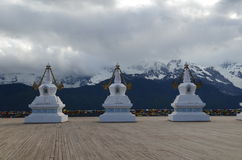 Stupas Infront of Sacred Buddhist Meili Mountain Royalty Free Stock Photos