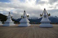 Stupas Infront of Sacred Buddhist Meili Mountain Royalty Free Stock Image