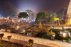 The stupas near Mahabodhi Temple decorated to celebration of Buddhist new year. The place of an enlightenment of Buddha, Mahabodhi Temple and stupas in beams of Royalty Free Stock Photography