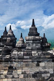 stupas surrounding Buddhist temple of Borobudur Royalty Free Stock Photos