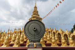 Stupas in Thailand. Gold stupas and grey Cloudy in Thailand stock photos