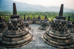 Stupas on top of Borobudur Temple in Indonesia. The island of Java. Royalty Free Stock Images