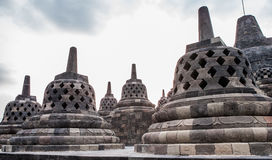 Stupas on top of Borobudur Temple in Indonesia. The island of Java. Royalty Free Stock Photo