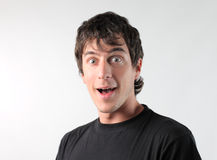 Stupefied man. Young man with astonished expression Stock Photo