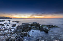Stupendous rocky seacost after sunset Royalty Free Stock Image