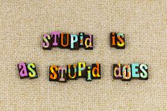 Stupid ignorant sexism prejudice. Stupid is does typography letterpress im not with humorous wisdom knowledge feminism feminist comments stupidity man woman royalty free stock photography