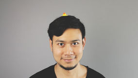 Stupid guy with a toy on his head. An asian man with black t-shirt royalty free stock images
