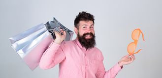 Stupid things you do with your money. How to stop buying things you dont need. Obsessed with shopping. Addicted consumer. Concept. Man carefree bearded hold stock image