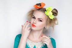 Stupid woman art. Closeup portrait of beautiful girl woman lady, professional manicure make up, hair styling. Luxury accessory New Bright orange color, shiny Royalty Free Stock Photo
