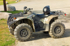 A sturdy ATV with a camouflage design royalty free stock photography