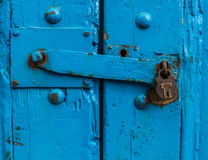 Sturdy Blue Door With Lock. Vintage Sturdy Blue Wooden Door With Heavy Metal Lock Royalty Free Stock Image