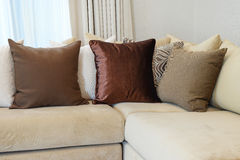 Sturdy brown sofa with brown patterned pillows. Sturdy brown tweed sofa with brown patterned pillows Royalty Free Stock Photography