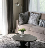 Sturdy brown tweed sofa with grey patterned pillows.  Royalty Free Stock Images