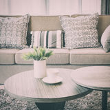 Sturdy brown tweed sofa with grey patterned pillows. Vintage style effect Stock Photo