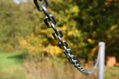 Sturdy chain of iron on a lawn. Robust iron chain defines green of a lawn stock images