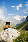Sturdy climber boot. Vintage climber boot is being dried in the base camp in Caucasian mountains Stock Images