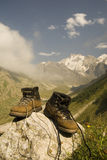 Sturdy climber boots. Vintage climber boots are dried in the base camp in mountains royalty free stock photos