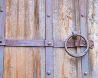 Sturdy door guarding the castle cellars. Royalty Free Stock Photography