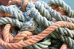 Sturdy hemp rope and nylon for sea fishermen. In the harbour area Royalty Free Stock Photography