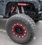 A high performance suspension system for an off-road vehicle. A sturdy jeep with heavy-duty springs used for extreme driving adventures Royalty Free Stock Photo