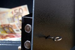 A Safe with cash or money. Sturdy safe with opened door and view of euro banknotes Stock Images