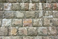 Stone-made solid wall. Sturdy and solid solid stone wall Stock Image