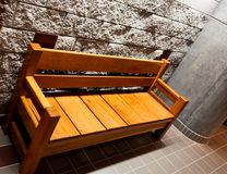 Sturdy wooden bench with arms royalty free stock images