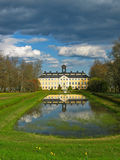 Sturefors castle. Famous castle near Linkoping in Sweden, The manor house and park with lime tree avenues and pond with reflections under the thunder storming Royalty Free Stock Images