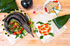 Sturgeon baked with vegetables and greens Royalty Free Stock Images