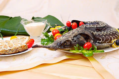 Sturgeon baked with vegetables and greens Stock Image