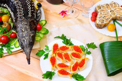 Sturgeon baked with vegetables and red caviar Royalty Free Stock Photos
