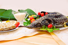 Sturgeon baked with vegetables, selective focus Stock Photos