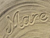 Stute schreiben auf den Sand Lizenzfreie Stockfotos