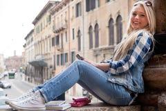 Stutent girl spending some time outdoors Stock Photo