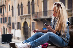 Stutent girl spending some time outdoors. In an European City as a tourist Royalty Free Stock Image