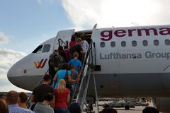 Stuttgart Airport. Tourists are boarding a German Wings plane at Stuttgart Airport Royalty Free Stock Photography