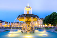 Stuttgart city center, Germany at dusk. Fountain at neues Schloss New palace in Stuttgart city center, Germany at dusk royalty free stock photography