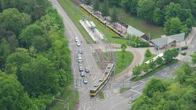 Stuttgart, Germany. Aerial view of the road crossing with the subway line. Aerial view stock footage