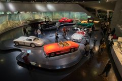 STUTTGART, GERMANY - DECEMBER 30, 2018: Interior of museum. `Mercedes Benz Welt`. The museum covers the history of the Mercedes-Benz and the brands associated royalty free stock photos