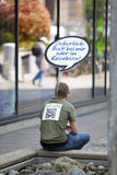 STUTTGART,GERMANY- MAY 31, 2012: the person on the city street with rest advertizing it is written in German- club vacation. boo Royalty Free Stock Image