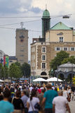 STUTTGART,GERMANY- MAY 31, 2012: Street scene on the central street and tower of Stuttgart Central Station with the rotating Merce Royalty Free Stock Photo